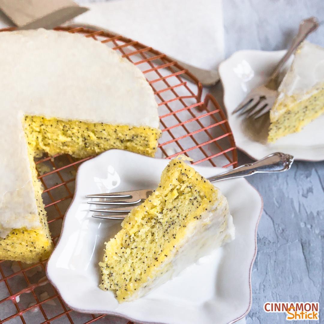 Slice of Lemon Poppyseed Stovetop Cake with cake behind it.
