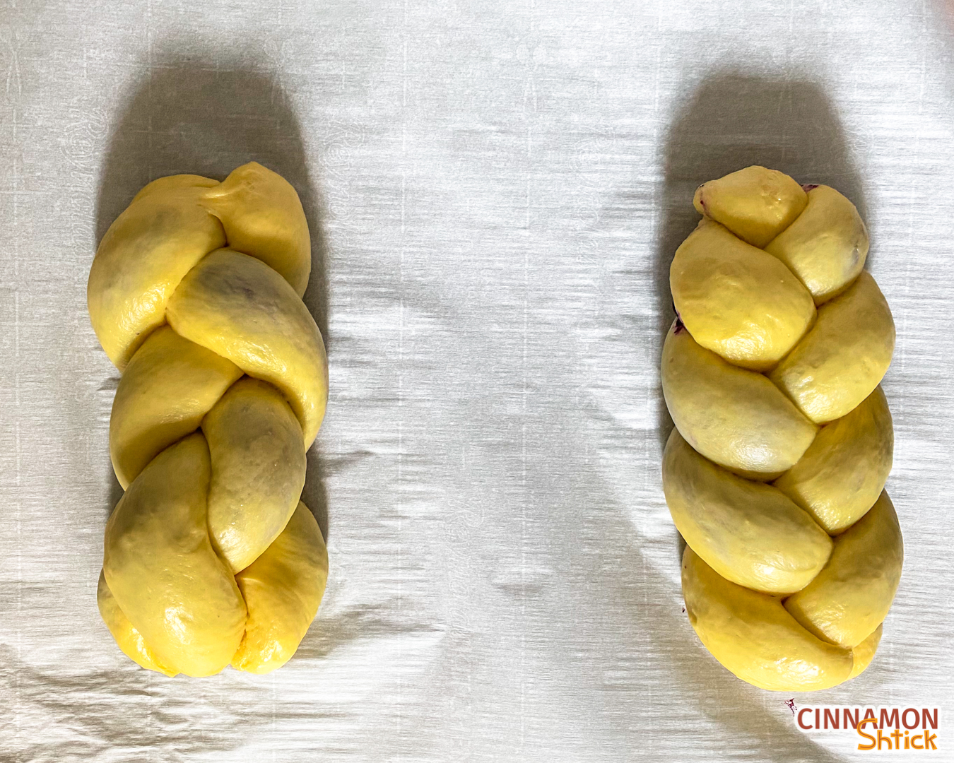 2 loaves of babkallah braided, each with 3 strands