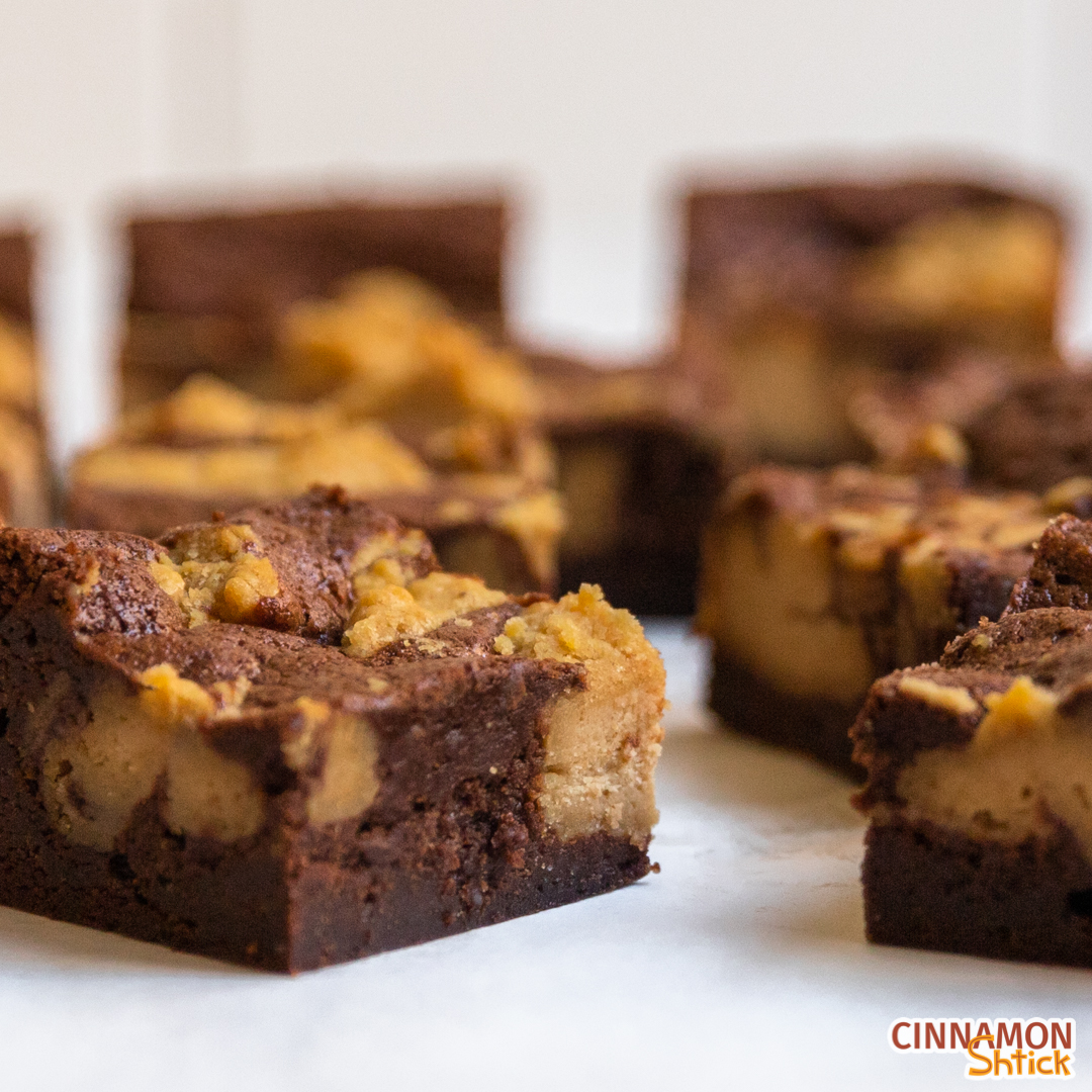 Close up of peanut butter cheesecake brownies spread on countertop