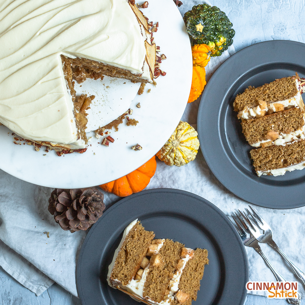 Overhead view of two plated slices of cake with plate on cake plate