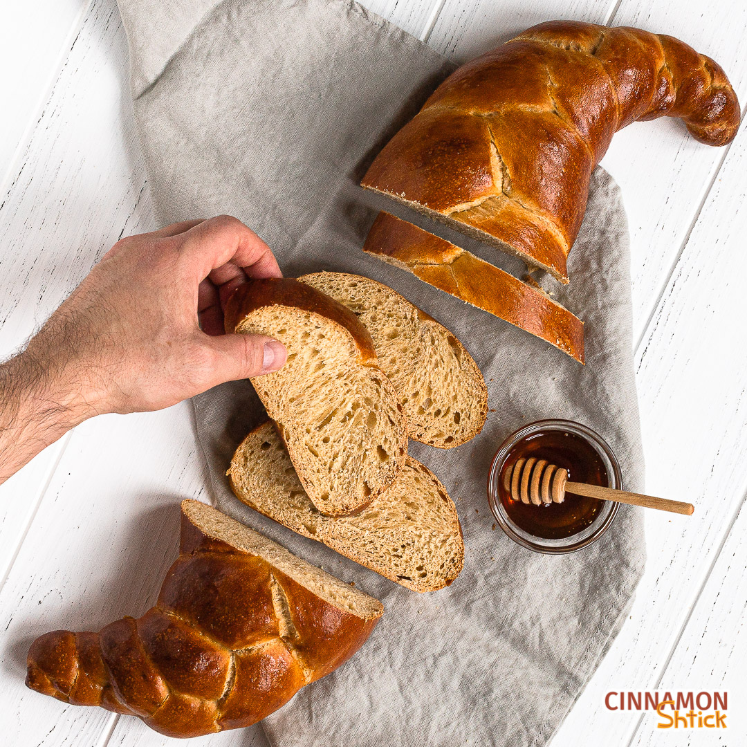 hand holding a slice of sourdough challah