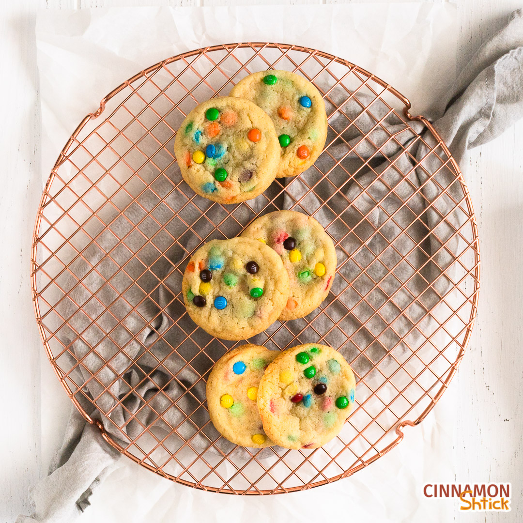 6 M&M cookies on round cooling rack