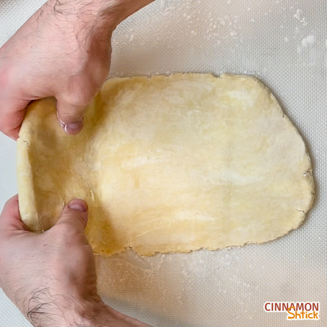Dough being folded onto itself