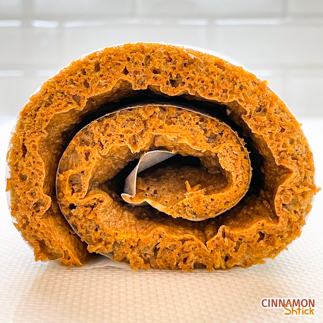 straight on view of the graham carrot cake rolled up in parchment paper
