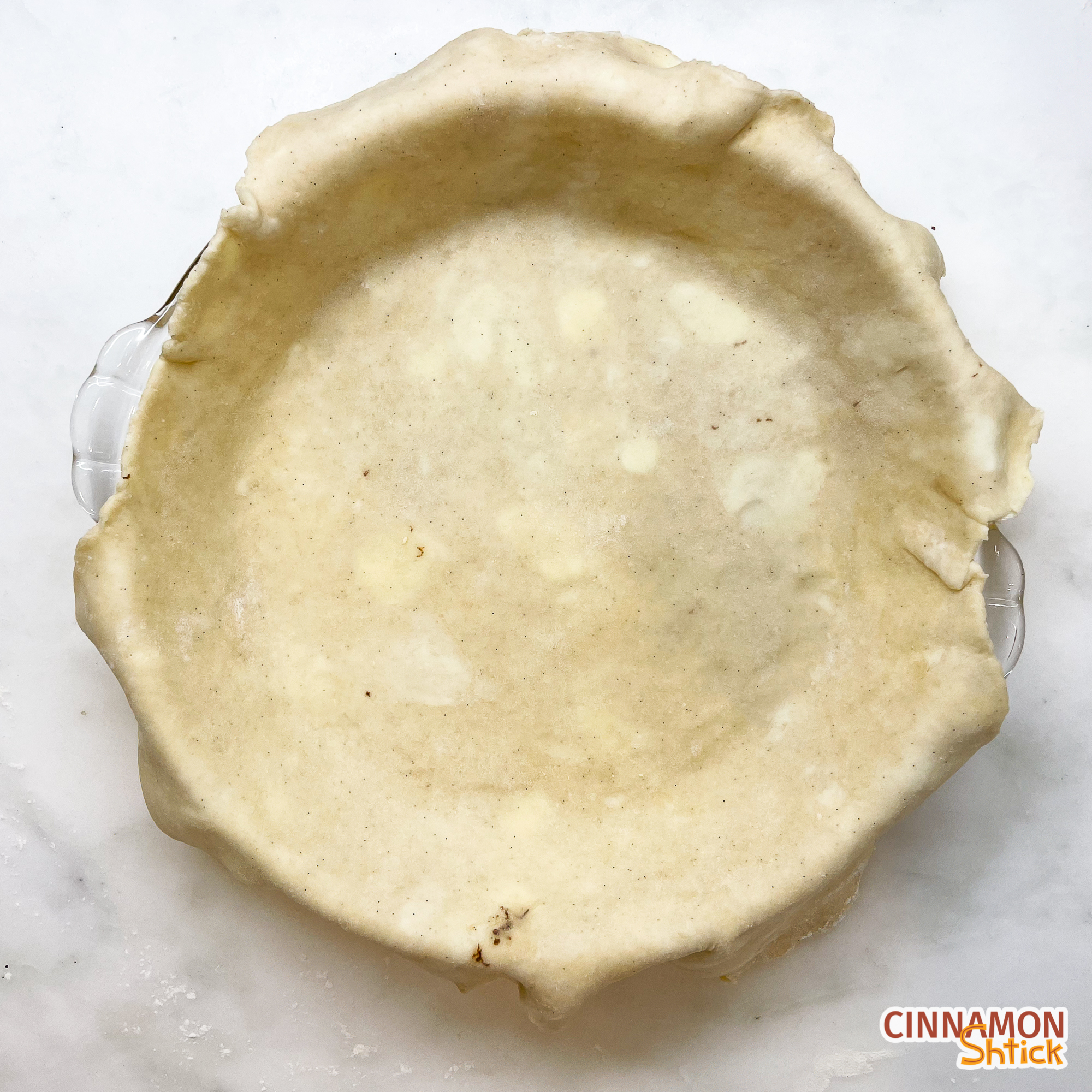 top view of pie dough just placed into pie dish