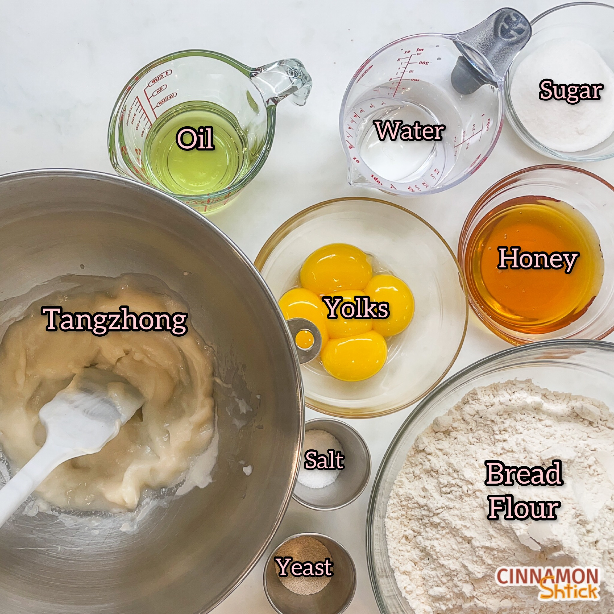 tangzhong in mixing bowl together with cups and bowls holding the rest of the challah ingredients, with each labeled as oil, water, sugar, honey, yolks, bread flour, salt and yeast